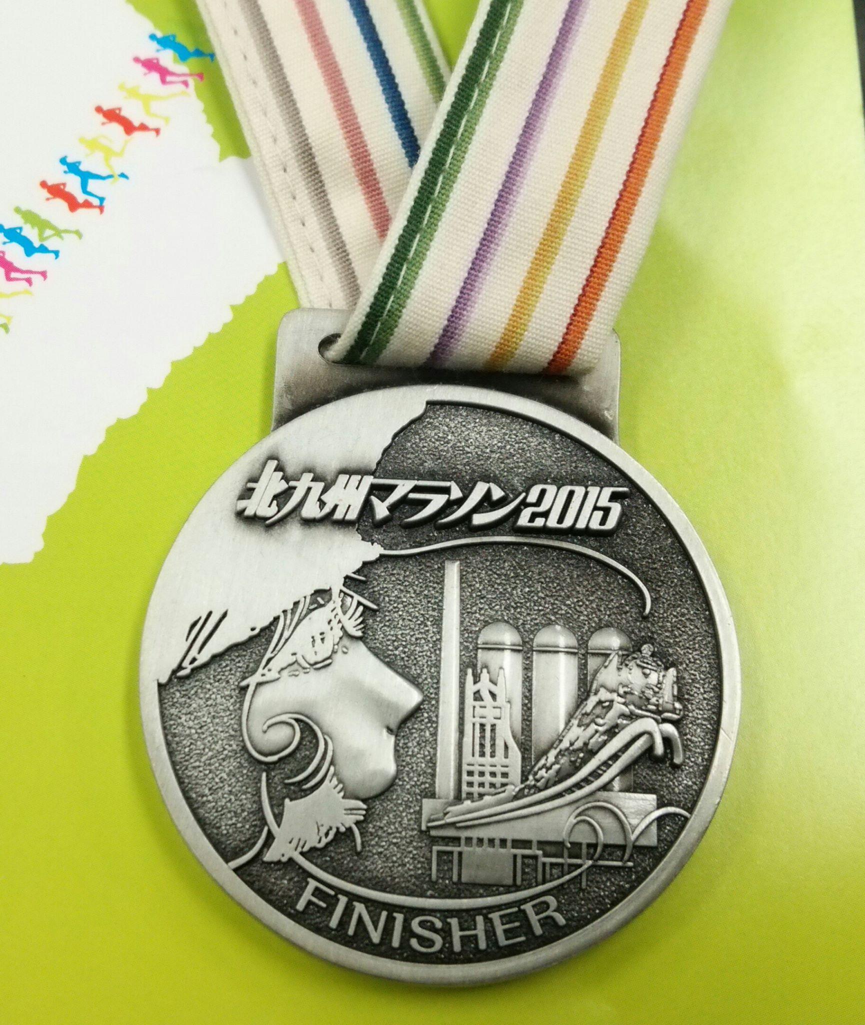 松本先生×小倉織のコラボメダル。 メーテルと東田第一高炉の図柄